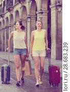 Купить «female tourists exploring old european city with baggage», фото № 28683239, снято 29 мая 2017 г. (c) Яков Филимонов / Фотобанк Лори