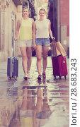 Купить «female tourists exploring old european city with baggage», фото № 28683243, снято 29 мая 2017 г. (c) Яков Филимонов / Фотобанк Лори