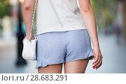 Купить «Female buttocks in blue shorts», фото № 28683291, снято 15 августа 2017 г. (c) Яков Филимонов / Фотобанк Лори