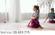 Купить «woman doing yoga exercise at studio», видеоролик № 28683715, снято 28 июня 2018 г. (c) Syda Productions / Фотобанк Лори