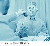 Купить «Mature man and manager contract car lease», фото № 28688939, снято 16 июля 2018 г. (c) Яков Филимонов / Фотобанк Лори
