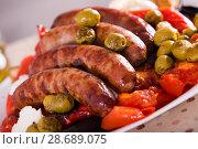 Купить «Grilled sausages and vegetables», фото № 28689075, снято 21 сентября 2018 г. (c) Яков Филимонов / Фотобанк Лори