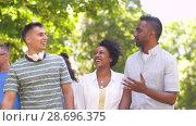 Купить «happy international friends walking in park», видеоролик № 28696375, снято 25 июня 2018 г. (c) Syda Productions / Фотобанк Лори