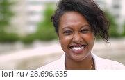 Купить «portrait of african american young woman outdoors», видеоролик № 28696635, снято 25 июня 2018 г. (c) Syda Productions / Фотобанк Лори