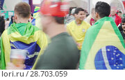 Купить «Wrap themselves with flags Brazil fans greet each other emotionally», видеоролик № 28703059, снято 6 июля 2018 г. (c) Ирина Мойсеева / Фотобанк Лори