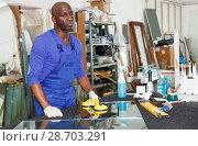 Купить «workman working with glass in workshop», фото № 28703291, снято 16 мая 2018 г. (c) Яков Филимонов / Фотобанк Лори