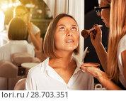 Купить «female makeup artist applying cosmetics for woman», фото № 28703351, снято 18 августа 2018 г. (c) Яков Филимонов / Фотобанк Лори