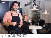 Купить «smiling man hairdresser and woman in salon», фото № 28703371, снято 25 сентября 2018 г. (c) Яков Филимонов / Фотобанк Лори