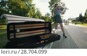 Купить «Case for violin lying on the bench in front of female who plays a fiddle at sunset», видеоролик № 28704099, снято 15 августа 2018 г. (c) Константин Шишкин / Фотобанк Лори