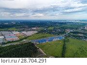 Купить «Aerial view of wheat fields, meadow, forest and village in rural Russia.», фото № 28704291, снято 11 июня 2018 г. (c) Андрей Радченко / Фотобанк Лори