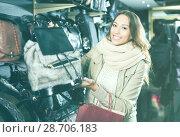 Купить «Smiling woman customer purchasing new handbag», фото № 28706183, снято 19 января 2019 г. (c) Яков Филимонов / Фотобанк Лори