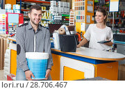 Купить «cheerful male customer with tools and seller at cash desk», фото № 28706467, снято 17 мая 2018 г. (c) Яков Филимонов / Фотобанк Лори