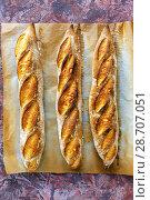 Купить «Freshly baked artisanal baguettes», фото № 28707051, снято 9 июля 2018 г. (c) Марина Сапрунова / Фотобанк Лори
