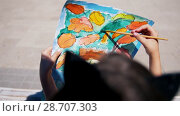 Купить «Little girl makes watercolor painting outdoors», видеоролик № 28707303, снято 17 июля 2018 г. (c) Константин Шишкин / Фотобанк Лори