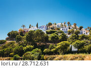 Village With Whitewashed Houses In Benahavis, Malaga, Andalusia, Spain. Summer Cityscape. Sunny Day With Good Weather. Стоковое фото, фотограф Ryhor Bruyeu / easy Fotostock / Фотобанк Лори