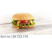 Купить «fresh homemade burger on a wooden table», фото № 28723115, снято 28 июня 2018 г. (c) Александр Лычагин / Фотобанк Лори