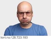 Купить «Funny bald man puffing out his cheeks.», фото № 28723183, снято 7 июля 2018 г. (c) Александр Лычагин / Фотобанк Лори