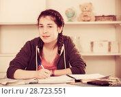 Купить «Girl doing homework», фото № 28723551, снято 29 марта 2017 г. (c) Яков Филимонов / Фотобанк Лори