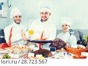 Купить «chefs offering fresh marine products for tasting», фото № 28723567, снято 26 января 2018 г. (c) Яков Филимонов / Фотобанк Лори