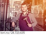 Купить «Master shows his tools and workplace», фото № 28723635, снято 15 марта 2017 г. (c) Яков Филимонов / Фотобанк Лори