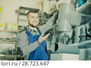 Купить «Young male worker examining sanitary drain pipes», фото № 28723647, снято 15 марта 2017 г. (c) Яков Филимонов / Фотобанк Лори