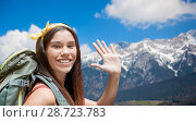 Купить «smiling woman with backpack over alps mountains», фото № 28723783, снято 25 июля 2015 г. (c) Syda Productions / Фотобанк Лори