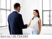 Купить «businesswoman and businessman shake hands», фото № 28724043, снято 8 июня 2018 г. (c) Syda Productions / Фотобанк Лори