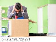 Купить «Male employee collecting his stuff after redundancy», фото № 28728291, снято 14 мая 2018 г. (c) Elnur / Фотобанк Лори