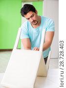 Man repairing furniture at home. Стоковое фото, фотограф Elnur / Фотобанк Лори