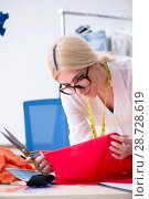 Купить «Woman tailor working on new dress designs», фото № 28728619, снято 13 апреля 2018 г. (c) Elnur / Фотобанк Лори