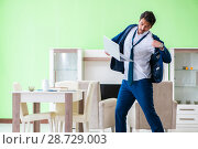 Купить «Man dressing up and late for work», фото № 28729003, снято 21 мая 2018 г. (c) Elnur / Фотобанк Лори