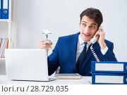 Купить «Young handsome businessman employee working in office at desk», фото № 28729035, снято 23 ноября 2017 г. (c) Elnur / Фотобанк Лори