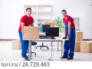 Купить «Two contractor employees moving personal belongings», фото № 28729483, снято 26 апреля 2018 г. (c) Elnur / Фотобанк Лори