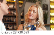 Купить «happy women drinking wine at bar or restaurant», видеоролик № 28730599, снято 4 июля 2018 г. (c) Syda Productions / Фотобанк Лори
