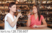 Купить «happy women drinking wine at bar or restaurant», видеоролик № 28730607, снято 6 июля 2018 г. (c) Syda Productions / Фотобанк Лори