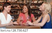 Купить «happy women drinking wine at bar or restaurant», видеоролик № 28730627, снято 4 июля 2018 г. (c) Syda Productions / Фотобанк Лори