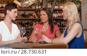 Купить «happy women drinking wine at bar or restaurant», видеоролик № 28730631, снято 4 июля 2018 г. (c) Syda Productions / Фотобанк Лори
