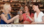 Купить «women giving present to friend at wine bar», видеоролик № 28730639, снято 4 июля 2018 г. (c) Syda Productions / Фотобанк Лори