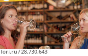 Купить «women with gift drinking wine at bar or restaurant», видеоролик № 28730643, снято 4 июля 2018 г. (c) Syda Productions / Фотобанк Лори