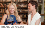 Купить «happy women drinking red wine at bar or restaurant», видеоролик № 28730663, снято 4 июля 2018 г. (c) Syda Productions / Фотобанк Лори