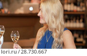 Купить «happy women drinking wine at bar or restaurant», видеоролик № 28730667, снято 4 июля 2018 г. (c) Syda Productions / Фотобанк Лори