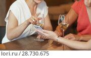 Купить «women with smartphone at wine bar or restaurant», видеоролик № 28730675, снято 4 июля 2018 г. (c) Syda Productions / Фотобанк Лори