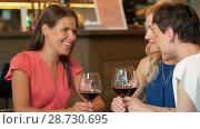 Купить «happy women drinking red wine at bar or restaurant», видеоролик № 28730695, снято 4 июля 2018 г. (c) Syda Productions / Фотобанк Лори