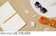 Купить «notebook, cocktails, hat and shades on beach sand», видеоролик № 28730699, снято 8 июля 2018 г. (c) Syda Productions / Фотобанк Лори