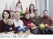 Купить «Friendly family making numerous photos», фото № 28731227, снято 27 мая 2019 г. (c) Яков Филимонов / Фотобанк Лори