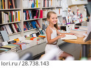 Купить «little smart girl reading a book in the school library», фото № 28738143, снято 16 июля 2018 г. (c) Татьяна Яцевич / Фотобанк Лори