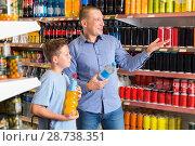 Купить «Father and son in store looking for mineral drinks», фото № 28738351, снято 4 июня 2018 г. (c) Яков Филимонов / Фотобанк Лори