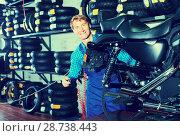 Купить «man in coveralls checking motorcycle», фото № 28738443, снято 21 сентября 2018 г. (c) Яков Филимонов / Фотобанк Лори