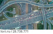Купить «Aerial top view of road junction in Moscow from above, automobile traffic and jam of many cars, transportation concept», видеоролик № 28738771, снято 9 июля 2018 г. (c) Mikhail Starodubov / Фотобанк Лори