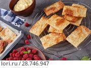 Купить «portions of puff pastry on a baking sheet», фото № 28746947, снято 4 июля 2018 г. (c) Oksana Zh / Фотобанк Лори